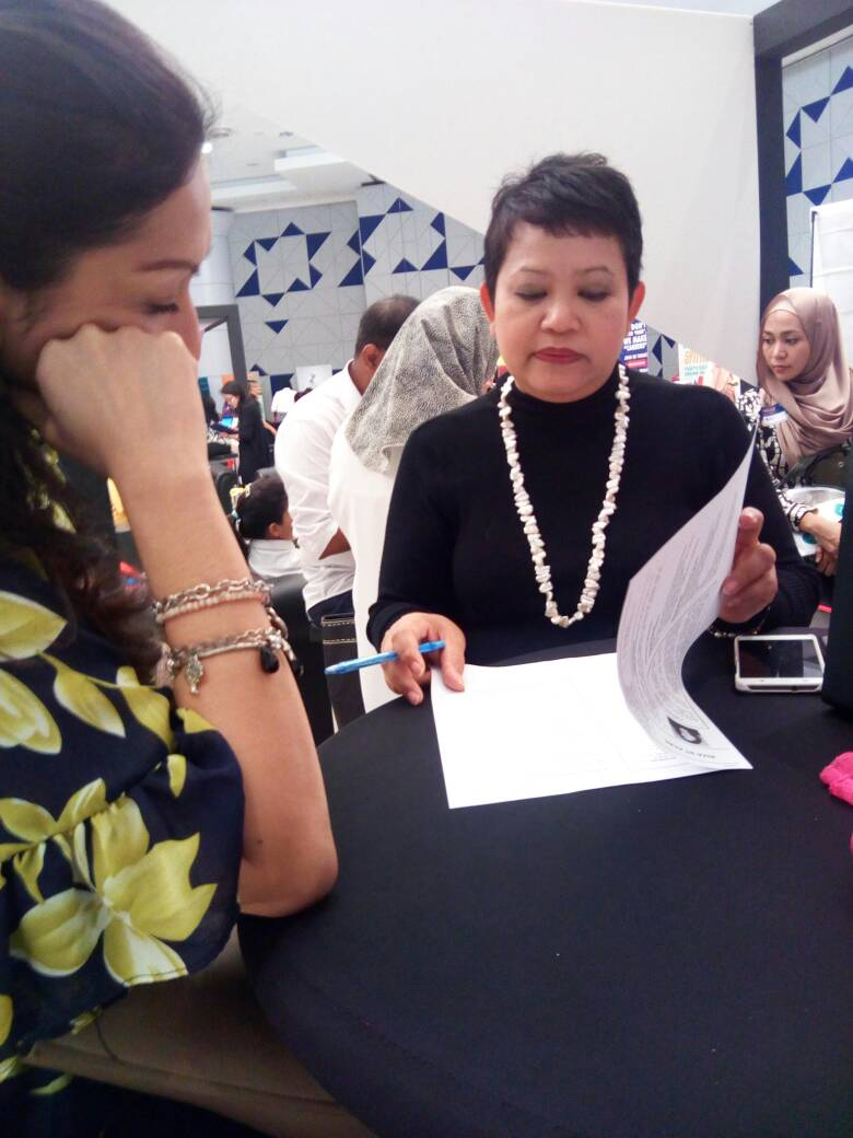 Photo of Hanie reviewing a participant's CV